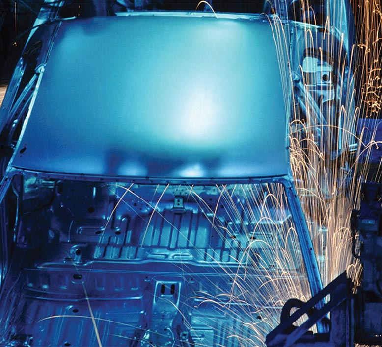 close up of automobile frame welding on a modern assembly line