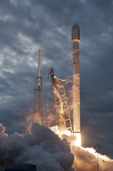 fiery liftoff of SpaceX rocket at twilight