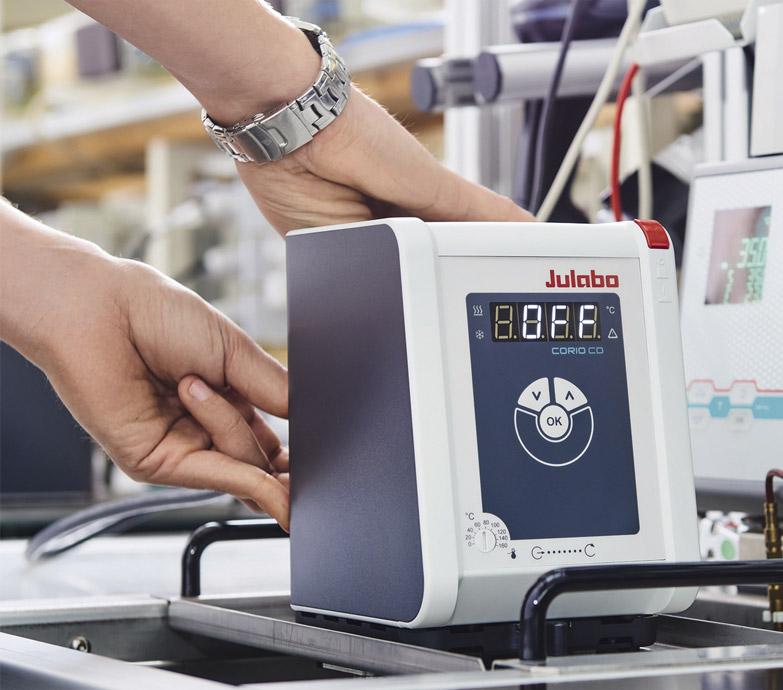 Technician installing a Corio CD component