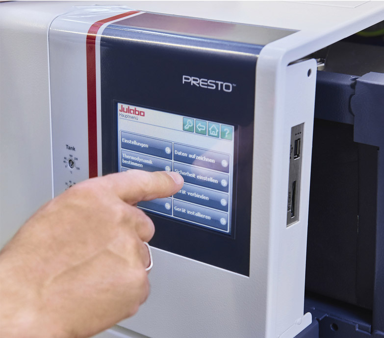 Hand of technician making a selection on the digital display of a Presto machine